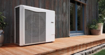 An externally mounted home unit sitting on a back deck of the house, providing efficient air conditioning.