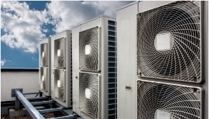 An image of a commercial HVAC system that is mounted on the roof of an industrial building in Daytona, Florida