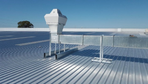 An installed ventilation system on top of a factory metal roof in Volusia county, Florida.