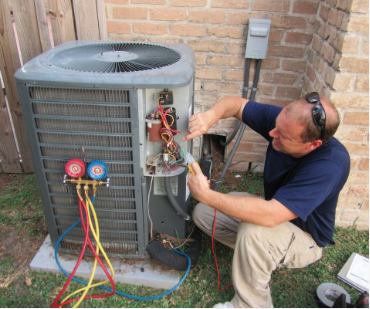 HVAC service professional assessing and fixing problems with a failed exterior unit.