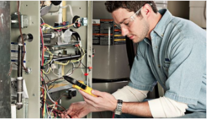 A technician uses specialized equipment to monitor and record the effectiveness of heating and cooling equipment.